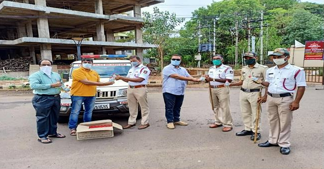 Distribution of Sanitizers to Police and HESCOM Staff